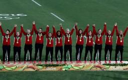 Bronze medalist team Canada celebrates on the podium