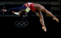 RIO DE JANEIRO, BRAZIL - AUGUST 09: Simone Biles of the United States competes on the balance beam during the Artistic Gymnastics Women's Team Final on Day 4 of the Rio 2016 Olympic Games at the Rio Olympic Arena on August 9, 2016 in Rio de Janeiro, Brazi