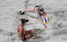 Kerri Walsh Jennings and April Ross of United States in action during the Women's Beach Volleyball preliminary round Pool C match against Fan Wang and Yuan Yue of China on Day 3 of the Rio 2016 Olympic Games at the Beach Volleyball Arena on August 8, 201