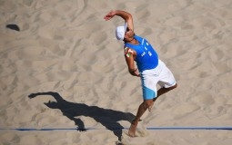 Adrian Carambula Raurich of Italy serves during the Men's Beach Volleyball preliminary round Pool A match against Clemens Doppler and Alexander Horst of Austria on Day 1 of the Rio 2016 Olympic Games at the Beach Volleyball Arena on August 6, 2016 in Rio