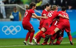 Sophie Schmidt #13 of Canada celebratestheir first goal against France.