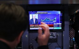 Traders work on the floor of the New York Stock Exchange (NYSE) Looking At Financial Numbers