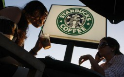 College students relax and drink their beverages at a Starbucks Coffee shop