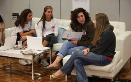 Young college students discuss their tasks for the internships.