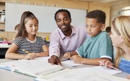 Black Male Teacher in the Classroom (IMAGE)
