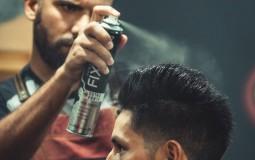 Barber using hairspray
