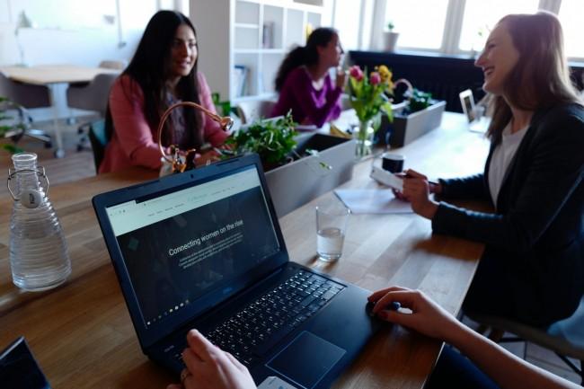 Three women on table