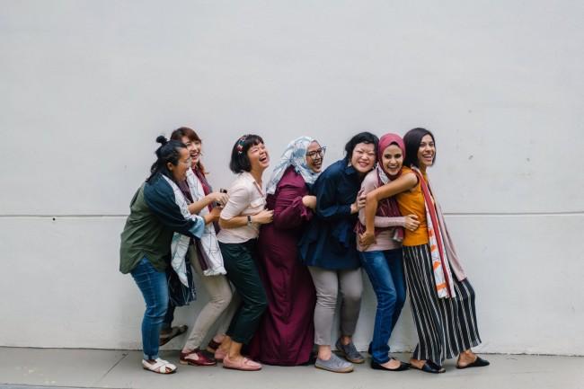 women falling in line