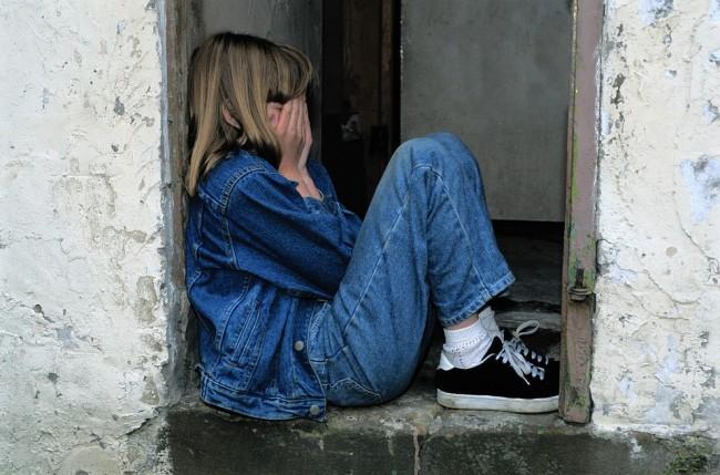 Child sitting in the doorway