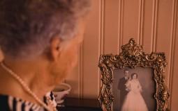 Woman staring at a photo