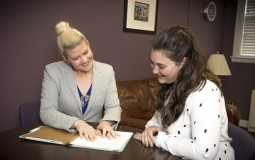 DIRECTOR OF THE ASPIRE CLINIC MEGAN FORD, LEFT, DISCUSSES A CASE WITH STUDENT PAIGE GARRISON.