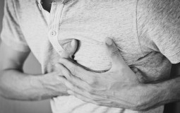 man holding his chest