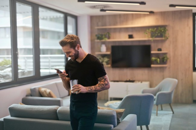 Man text messaging