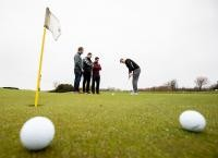 Researchers playing golf